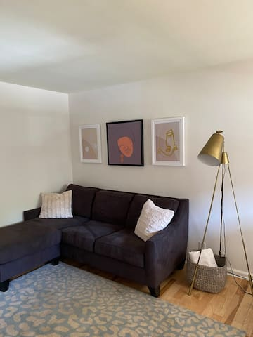 "Spacious living area. 38"" tv on wall."