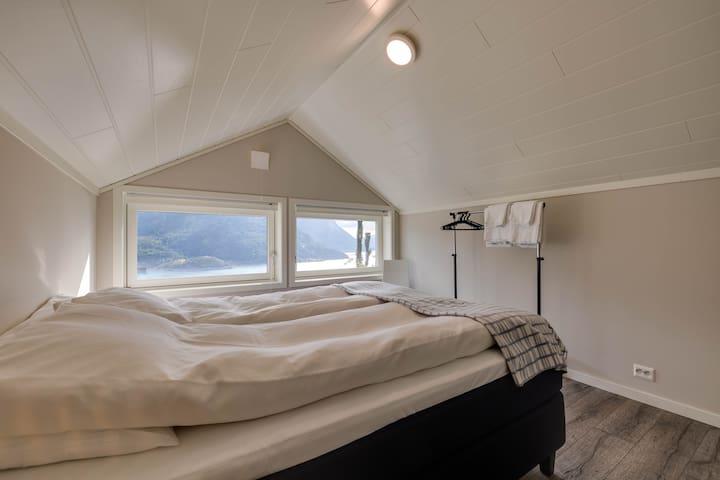 Second floor bedroom. Queen size bed.