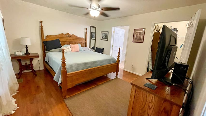 King size bed and Oak furniture in bedroom 1.  43 in TV.