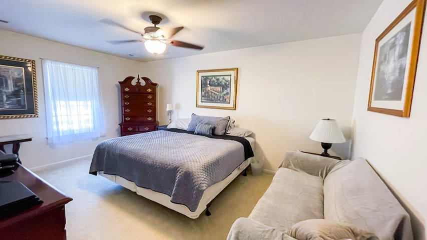 King size bed in Bedroom 2.  Has a timeless feel with Cherry furniture and a 43 inch TV.