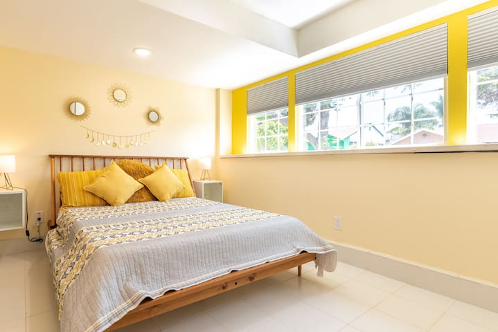 Comfortable queen size bed with yellow pops