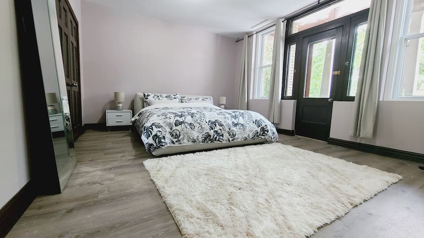 Master bedroom with new King size bed, new Leesa mattress and large dresser.