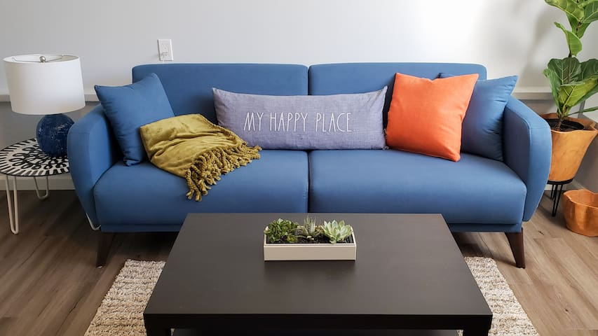 Your happy place! The comfy couch that easily coverts to an extra bed.