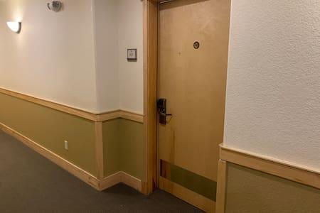 Unit front door. Elevator access.
