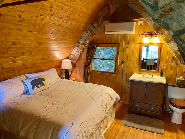 King Bed in the Loft with a 1/2 Bath. (This is very European!) There are heavy drapes you may draw closed for added privacy.