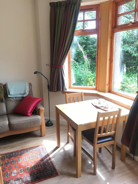 Studio flat in lovely garden with views.