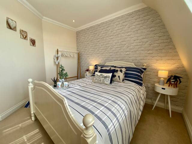 Main bedroom with views over the tennis courts & sea