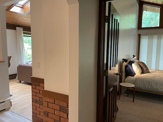 The view from the hall into the master bedroom