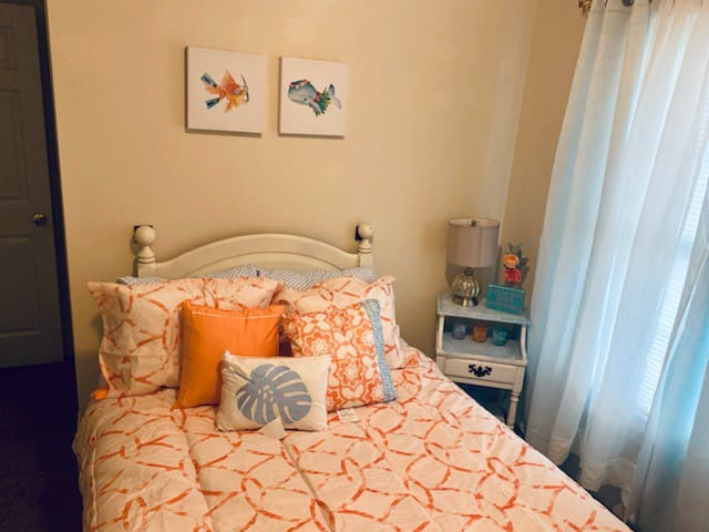 Bedroom perfect for the kid/kids with a full size bed and games.