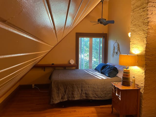 Master bedroom is your own treehouse! Wake up in the queen-sized bed to the sounds of the water feature out the window..