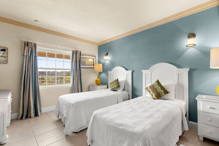 Third bedroom with two single beds and a view of St. Lawrence Gap.