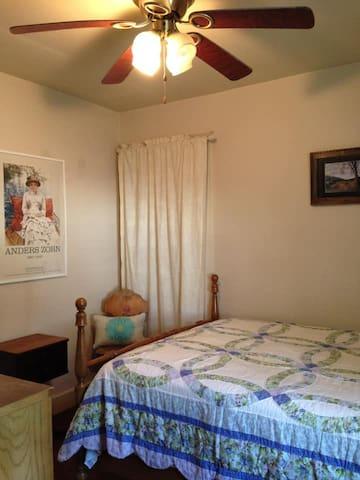 Bedroom #1. Double bed. Ceiling fan. Window AC unit.