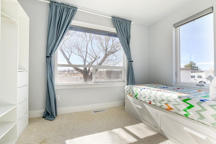 Guest bedroom with twin sized bed that can be pulled out to a king size upon request.