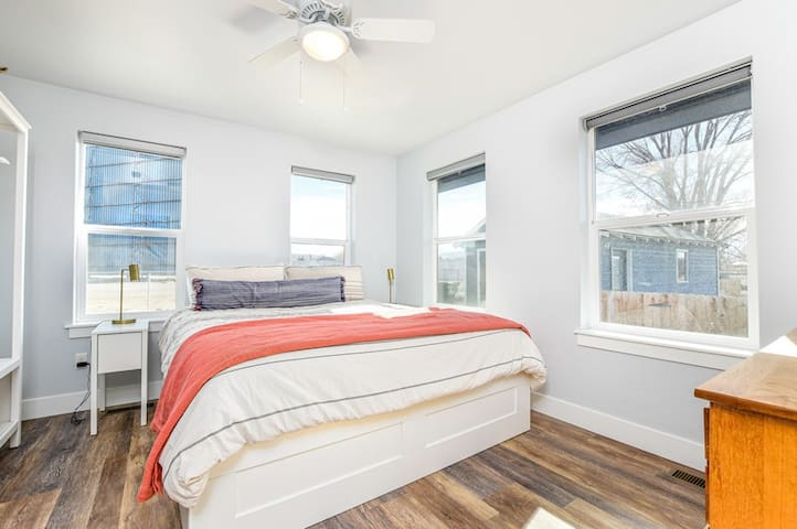 Master bedroom with KIng sized bed and attached bathroom and laundry area.