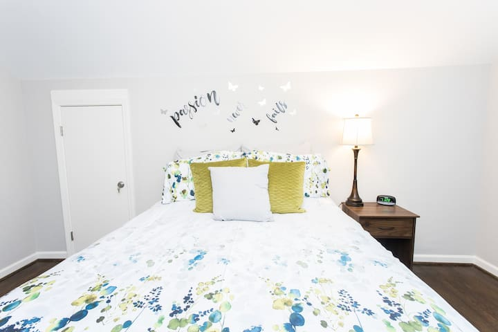 """""""Passion Never Fails""""- This queen sized bed is super comfy with plush pillows, soft sheets and a duvet that feels like a cloud. You'll need that alarm clock because you won't want to get out of this bed."""