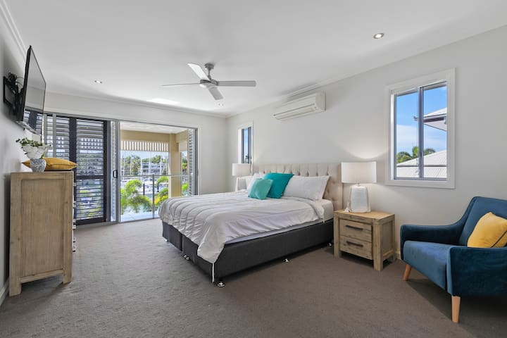 Master suite, opening out onto private balcony. Monster sized ensuite and generous walk in robe. Split system a/c, reading chair and wall mounted TV.
