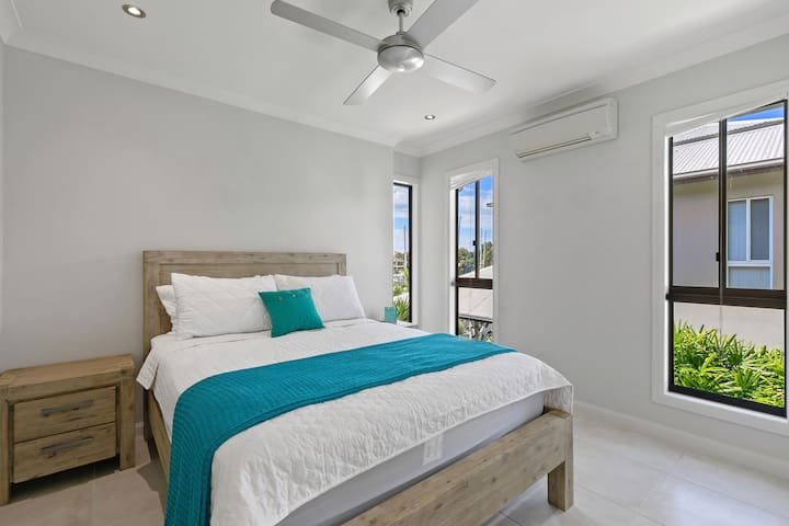 Bedroom 2 is filled with light with three windows. Gorgeous, comfy queen sized beds, split system a/c and built in robes.