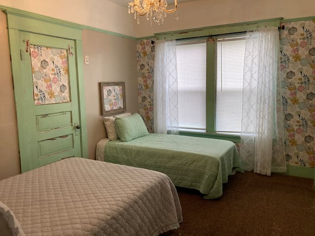 We left the mint green paint since we've found remnants of it throughout the home inside and out.  It is a piece of history.  The chandeliers in the bedrooms, and the tub are also original to the home for those who care to know.