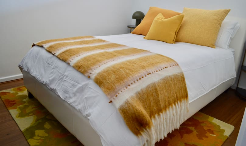 Bedroom 2 with queen size bed, Sealy pillow top mattress and bamboo linen. Bedside tables and lamps.