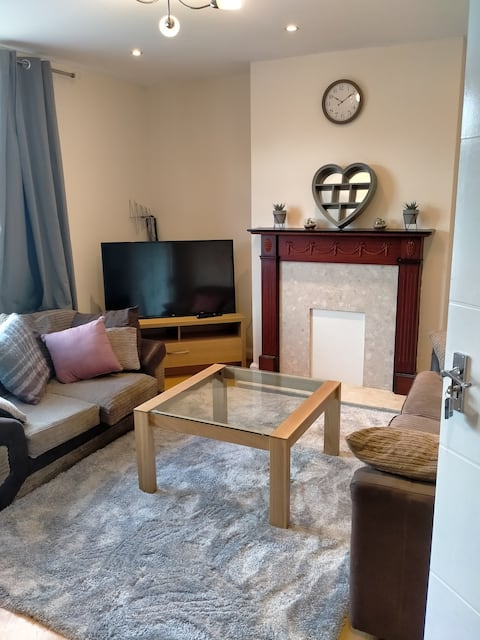 A cheerful 3 bedroomed house with a barbeque grill