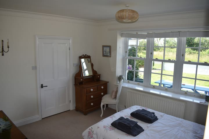 Bedroom with large window offering views