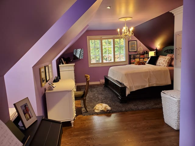 King Bed overlooking the side gardens. There is a television in this bedroom.