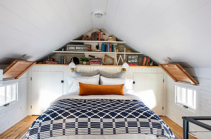 The upstairs loft includes a queen size bed and ample storage/closet space