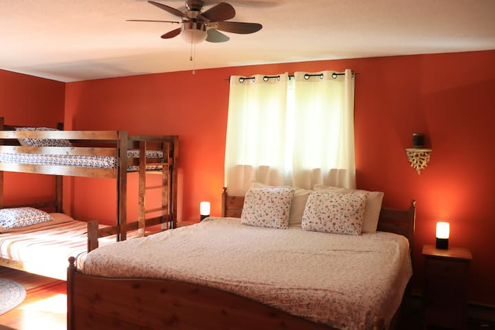 Large master bedroom with king-size bed and bunkbed for the kids.