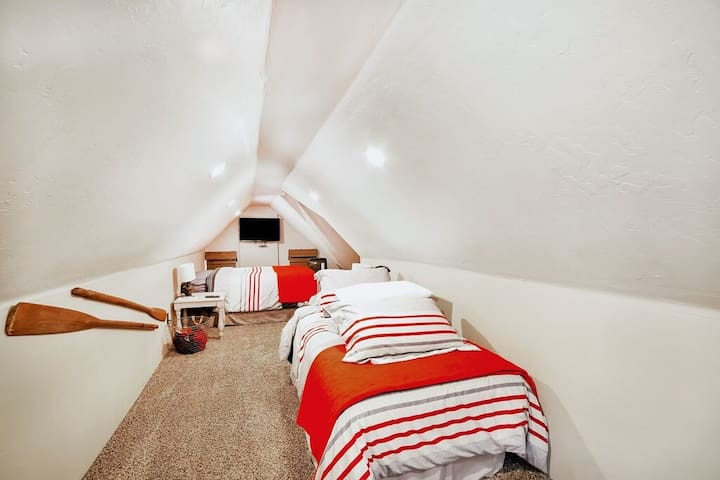 """This is """"living room 2."""" The single bed is now in """"bedroom 2."""" And the double bed pictures is now a single daybed that converts (with a trundle plus a memory-foam topper) to a king."""