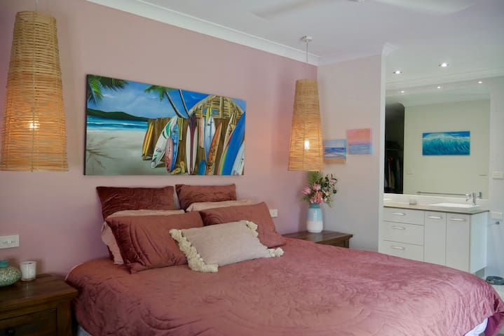Beautiful main bedroom with large en-suite with large shower space and gorgeous bathtub to relax and wind down, There's a  walk through closet, TV and double doors out onto the deck which can both be viewed from the luxurious king size bed.