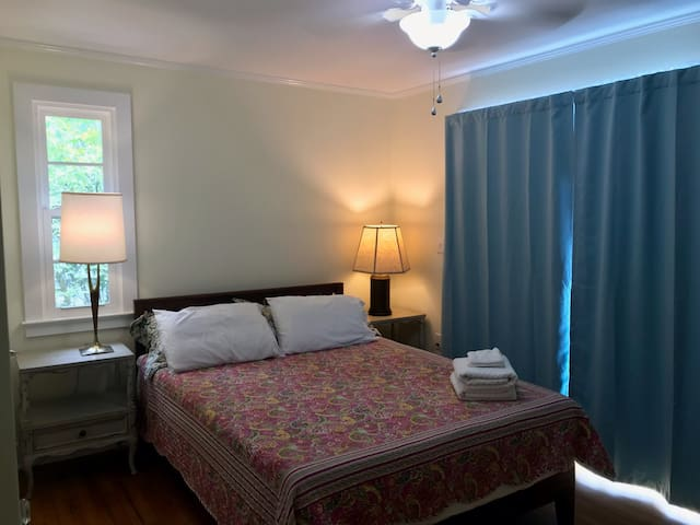The main guest bedroom has a closet, a new queen size bed & sliding glass door with deck overlooking the water. Privacy curtains & sheers.