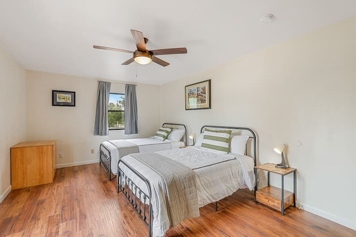Fourth Bedroom has two full beds, great for two kids or single people. This bedroom has its own private balcony as well as a desk/workstation.