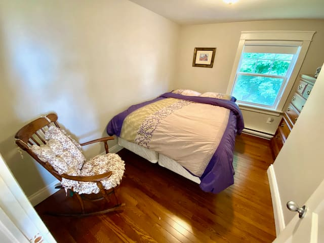 The 2nd room has queen bed with drawers on the side and chair