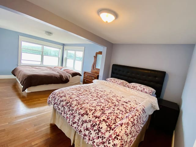 The main bedroom comes with a king and queen bed with an en-suite bath plus plenty of space in the room