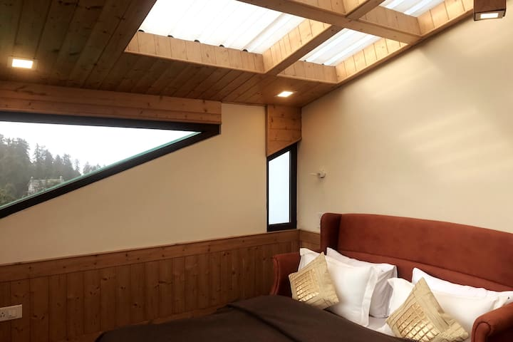 Bedroom 5 - panoramic views, when it snow's (you can see snow falling on top)