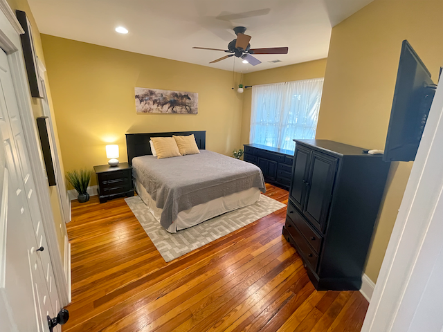 Second bedroom with king bed and private full bathroom. Bedrooms are located at opposite ends of the house for privacy.