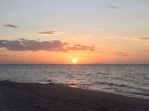 Departamento vista al mar, sol, playa y flamencos