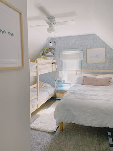 Bedroom #3 features a queen size bed and twin bunk beds. There is also a work/vanity space and a closet.