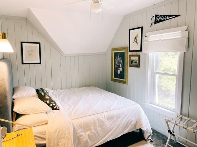 Bedroom #2 is the smallest but features a king size bed, dresser, vanity space, and a small closet.