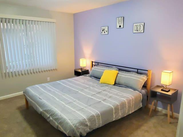 Master bedroom with King bed and en suite half bathroom