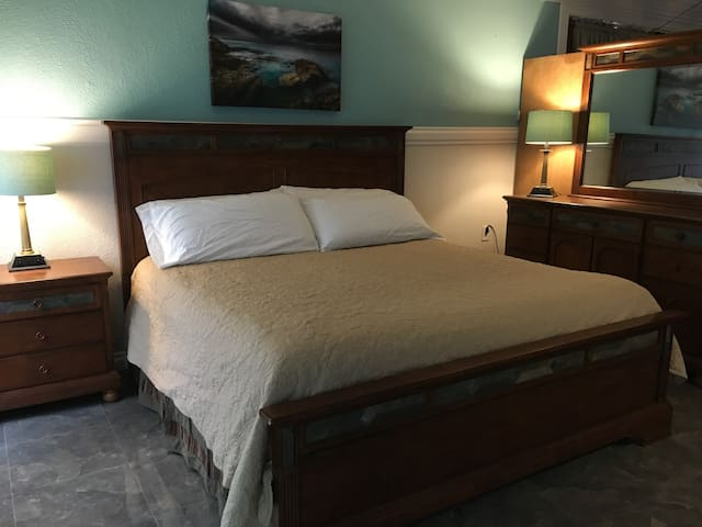 Master suite bedroom with king size bed and USB ports at each side of the bed