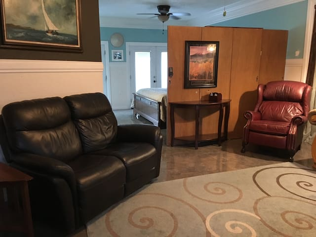 Master suite den and entertainment room with 65 inch Smart TV