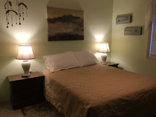"""Second bedroom with queen size bed, USB ports on each side, and 43"""" Smart TV."""