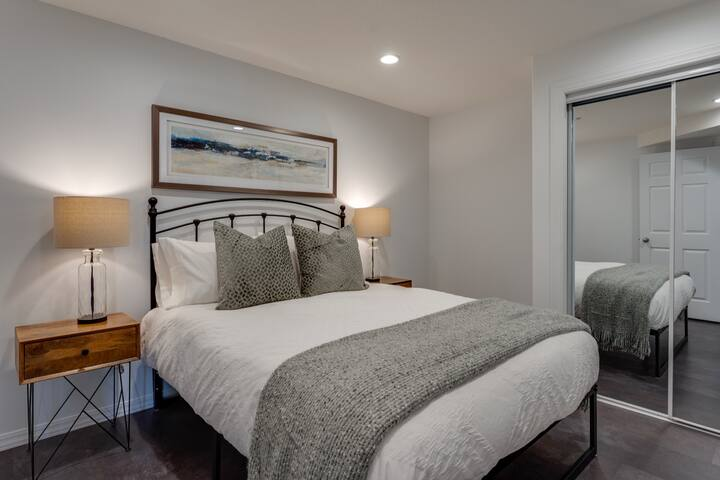 Second bedroom with queen bed and access across from main bath. Pack n Play provided for the littles.