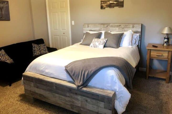 Master Bedroom Queen bed and futon