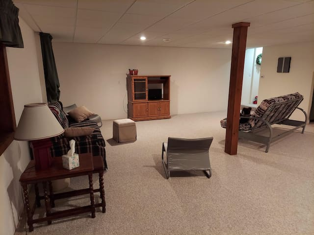 Lower level recreation room with futon for additional sleeping space .