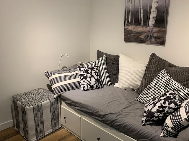 den with day bed converts to twin bed for 5th guest