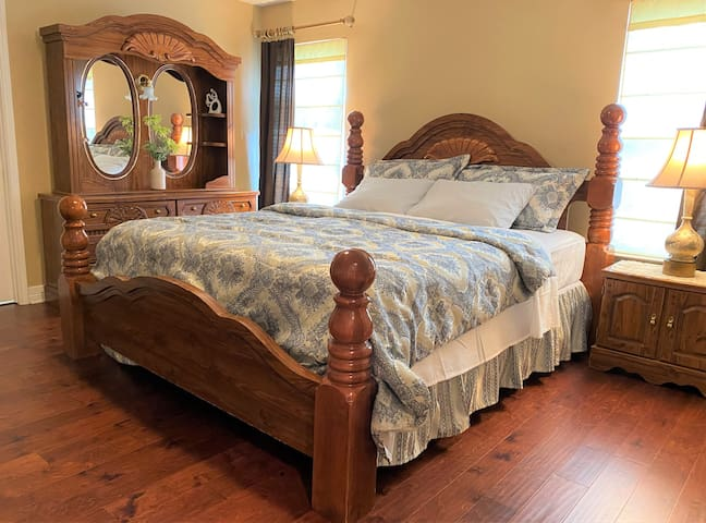 Master Bedroom is located downstairs with a King Bed set. Has an attached bathroom and walk-in closet.