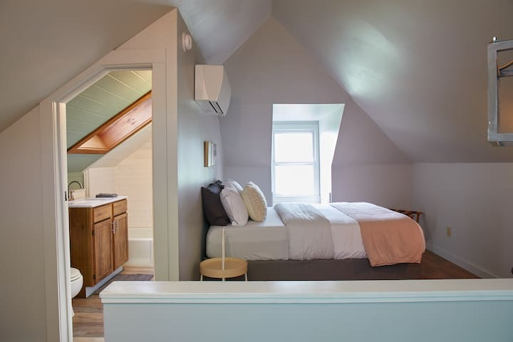 Upstairs bedroom suite with queen bed and full bathroom and its own split unit AC/heater.