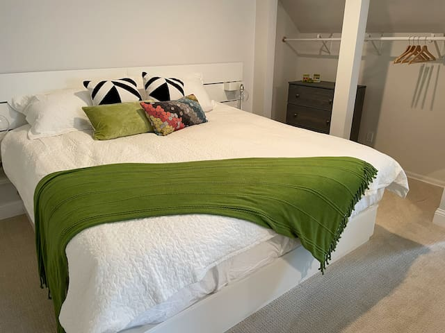 King bed upstairs with large closet. USB charging lamps for your convenience at the bedside.